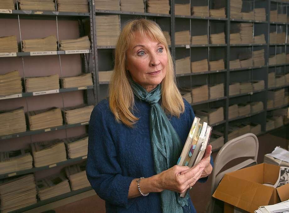 """Actor and playwright Lorri Holt, who originated the role of Harper Pitt in Tony Kushner's """"Angels in America"""" holds on to her journals as she gets ready to do a podcast at The Chronicle. Photo: Liz Hafalia / The Chronicle"""