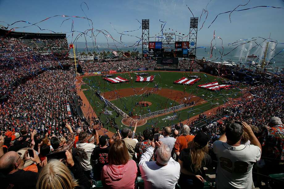The playing of the national anthem during opening day before a baseball game between the San Francisco Giants and Seattle Mariners at AT&T Park, Tuesday, April 3, 2018, in San Francisco, Calif. Photo: Santiago Mejia / The Chronicle