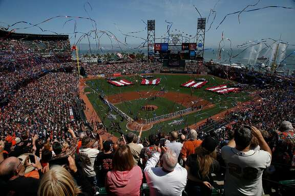 The playing of the national anthem during opening day before a baseball game between the San Francisco Giants and Seattle Mariners at AT&T Park, Tuesday, April 3, 2018, in San Francisco, Calif.