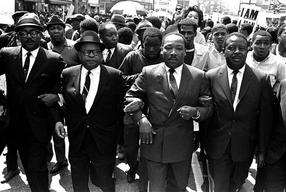 The Rev. Ralph Abernathy, right, and Bishop Julian Smith, left, flank Dr. Martin Luther King, Jr., during a civil rights march in Memphis, Tenn., March 28, 1968. A week later, King was assassinated, 50 years ago today. Photo: JRT /AP / AP