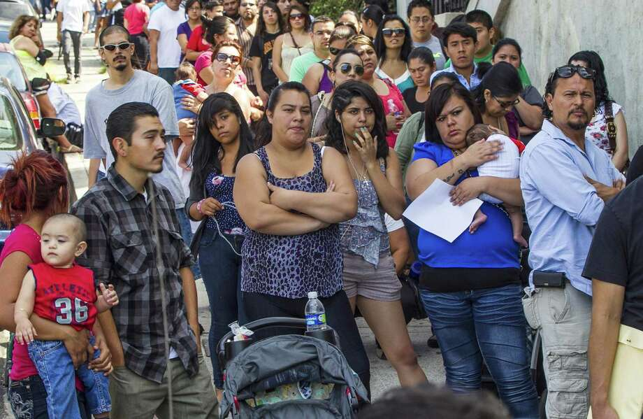 A line of people living in the U.S. without legal permission wait outside the Coalition for Humane Immigrant Rights in Los Angeles in 2012. People in such circumstances may forgo participating in the 2020 census altogether if the form contains a citizenship question, prompting California to sue the Trump administration over the decision. Photo: Damian Dovarganes /Associated Press / Copyright 2018 The Associated Press. All rights reserved.