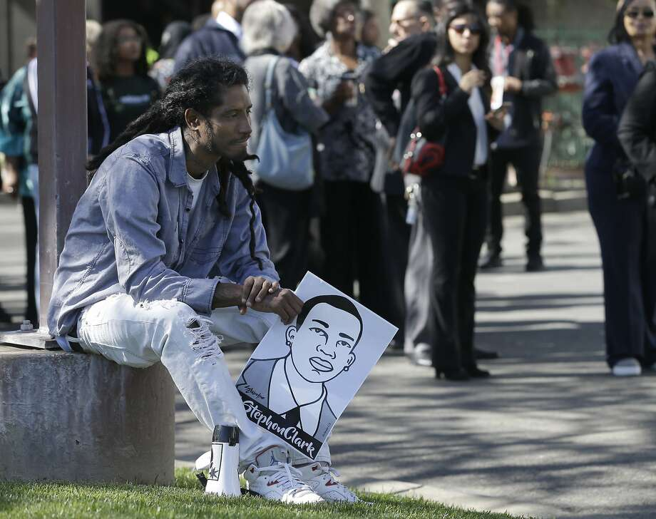 Steven Ash holds a drawing of police shooting victim Stephon Clark as he waits to enter the Bayside of South Sacramento Church on Thursday for Clark's funeral. Photo: Rich Pedroncelli / Associated Press