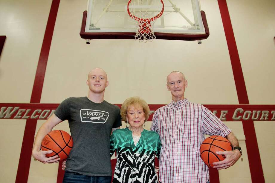 Clear Creek High School's basketball court is named for Buddy Carlisle, right,  its fieldhouse for his dad, George, and Deer Park High School's basketball court for his brother, Billy.  Also shown are Peggy Carlisle, George's wife and mother to Buddy and Billy, and Weston Carlisle, who is one of Billy's three children. Photo: Pin Lim, Freelance / Copyright Forest Photography, 2018.