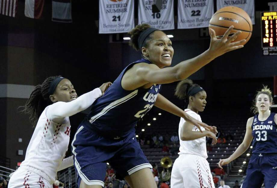 UConn's Azura Stevens pulls in a rebound in front of Houston's Octavia Barnes on Jan. 13 in Houston. Photo: Michael Wyke / Associated Press / © Associated Press 2017