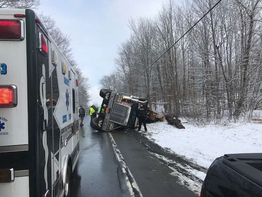 A log truck flipped on its side on Route 23 in Claverack on Monday. Photo: Columbia County Sheriff's Office