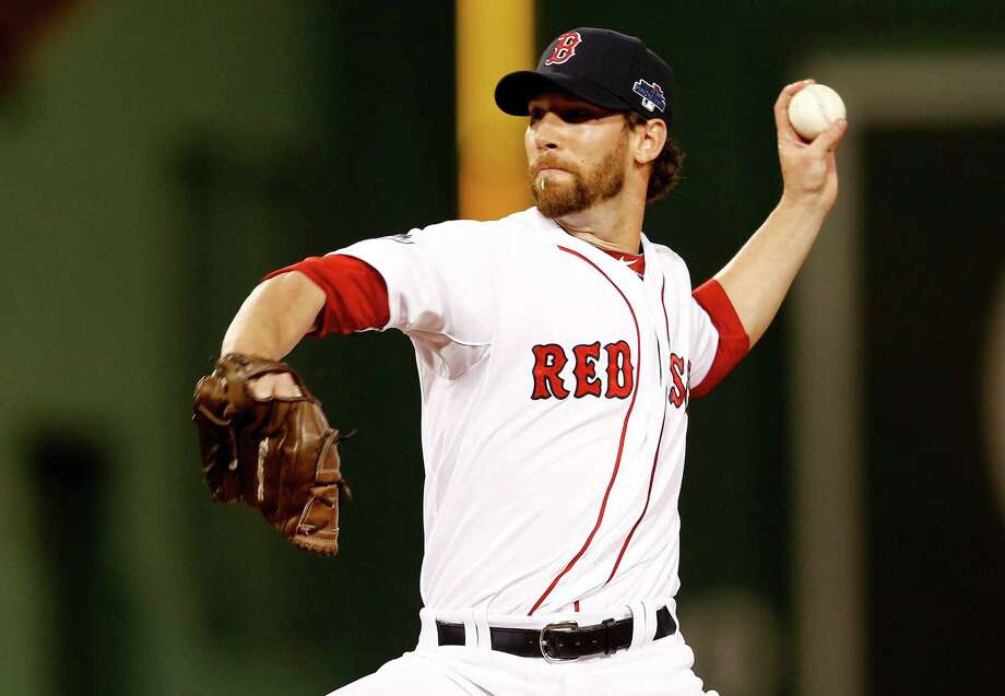 Craig Breslow, a former Trumbull and Yale star, pitches for the Red Sox against the Tampa Bay Rays in the American League Division Series on Oct. 5, 2013, at Fenway Park in Boston. Photo: Jim Rogash / Getty Images / 2013 Getty Images