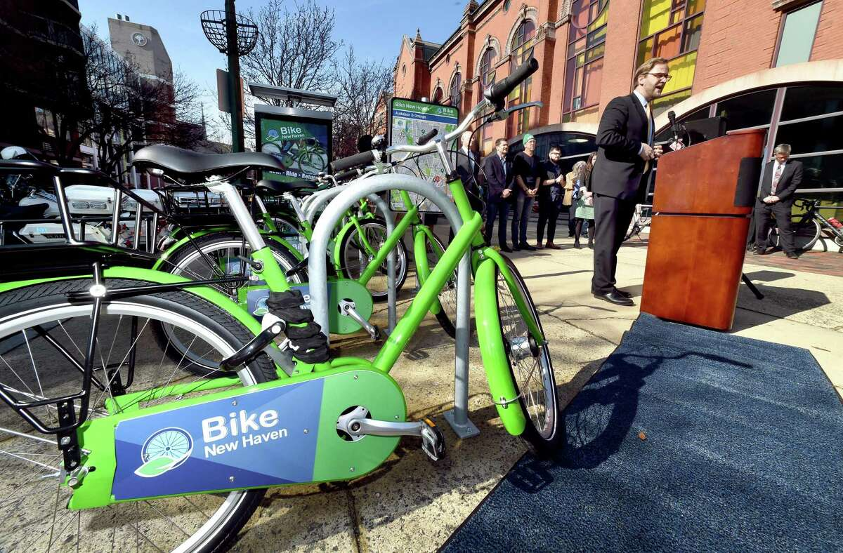 New Haven Transportation Director Doug Hausladen, right, speaks during the launch of Bike New Haven on Feb. 20. Norwalk's Bike/Walk Commission selected the same vendor, P3GM, on April 2 for its proposed bike share program.