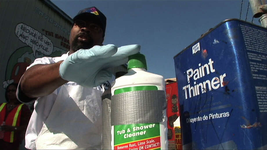 Roger Jones, the Household Hazardous Waste Manger for the  Environmental Service Center points outs chemical that can be hazardous during a press conference and demonstration to alert residents about the dangers of common household chemicals Friday, March 20, 2009, in Houston. ( Jason Witmer / Chronicle ) Photo: Jason Witmer, STAFF / Houston Chronicle