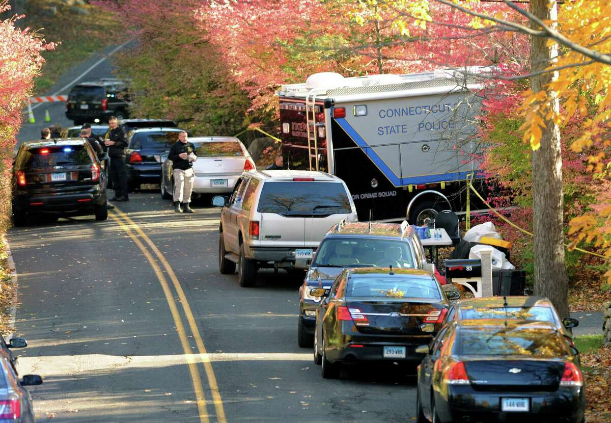 State Police search the area around a home in Weston, Conn., on Friday, Oct. 30, 2015, reportedly belonging to a friend of Kyle Navin.