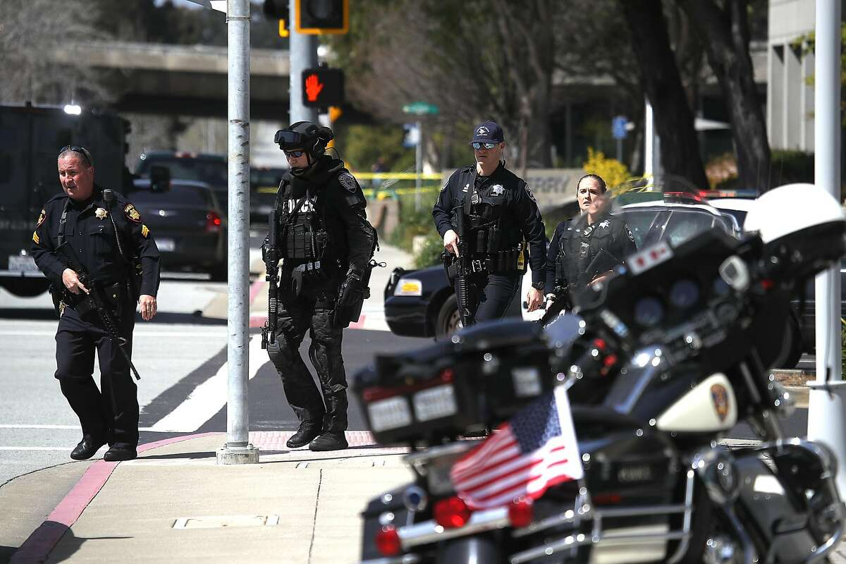 Police walk outside of the YouTube headquarters on April 3, 2018 in San Bruno, California. Police are investigating an active shooter incident at YouTube headquarters that has left at least one person dead and several wounded. (Photo by Justin Sullivan/Getty Images)