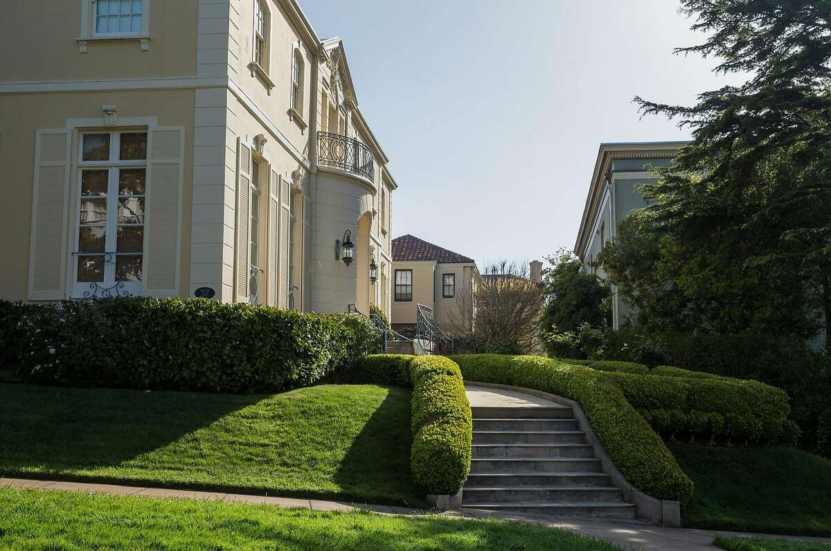 Freshly cut grass and hedges line a walkway to a home at 1 Presidio Terrace seen Tuesday, April 3, 2018 in San Francisco, Calif.