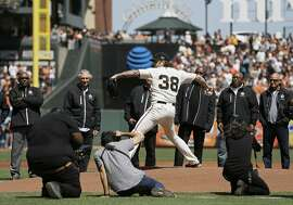 Former San Francisco Giants pitcher Brian Wilson throws a ceremonial first pitch before the start of an opening day baseball game between the Giants and the Seattle Mariners Tuesday, April 3, 2018, in San Francisco. (AP Photo/Eric Risberg)