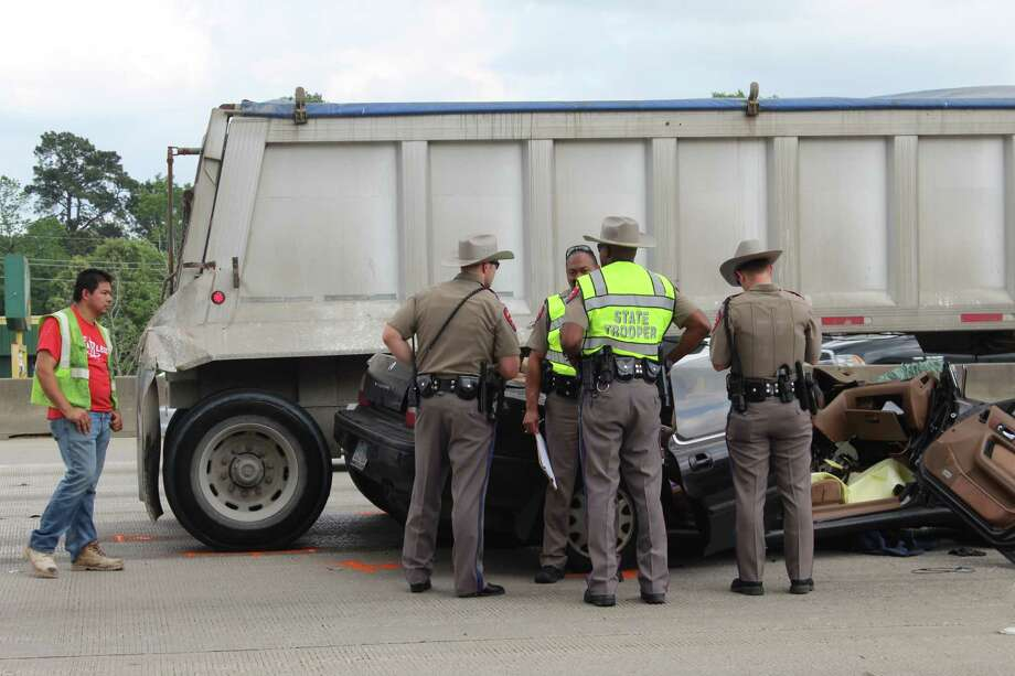 One person was in serious condition Tuesday after his car collided with an 18-wheeler at Interstate 45 Southbound at Nursery Road. Here law enforcement officials survey the accident scene. Photo: Michelle Iracheta