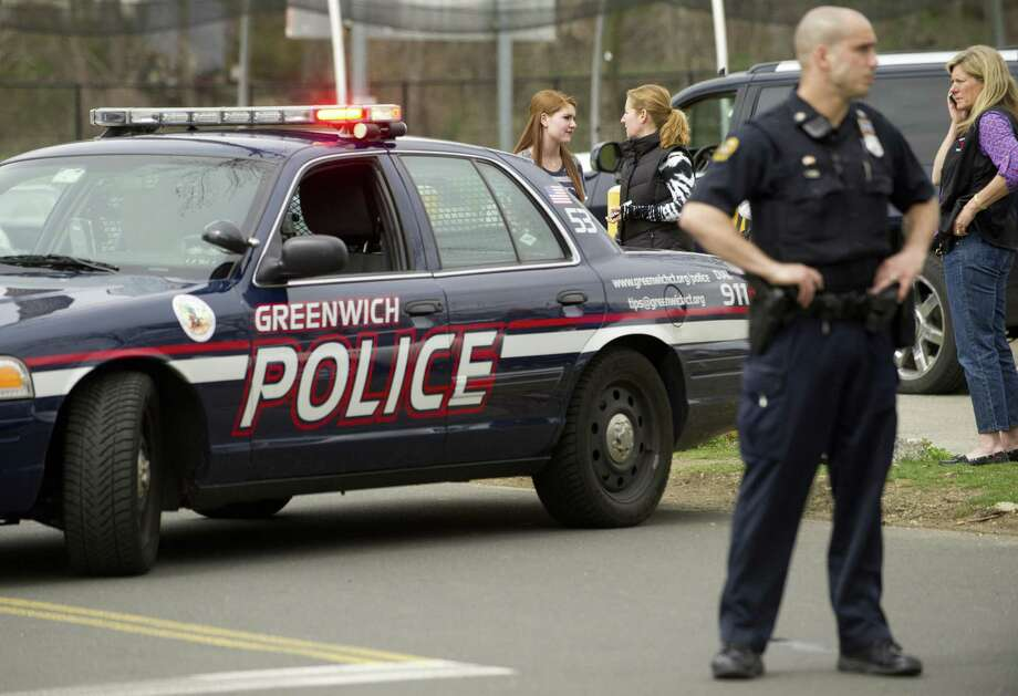 Police officers stand outside Greenwich High School after a lockdown at the school on April 11, 2013. Photo: Staff File Photo / Stamford Advocate