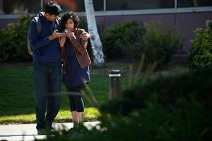 A man comforts a woman near the scene of an active shooter incident at YouTube headquarters in San Bruno, Calif. on Tuesday, April 3, 2018.