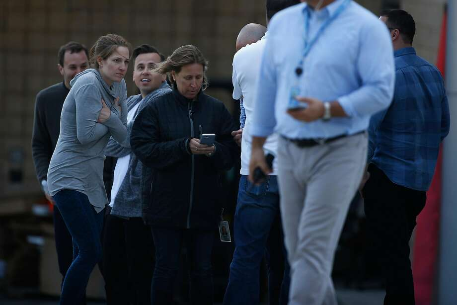 YouTube CEO Susan Wojcicki (center, looking at phone) is seen near the scene of the shooting incident at the YouTube headquarters in San Bruno. Behind her to the left is Vadim Lavrusik, a YouTube product manager who was among the first to tweet about the incident. Photo: Stephen Lam / Special To The Chronicle
