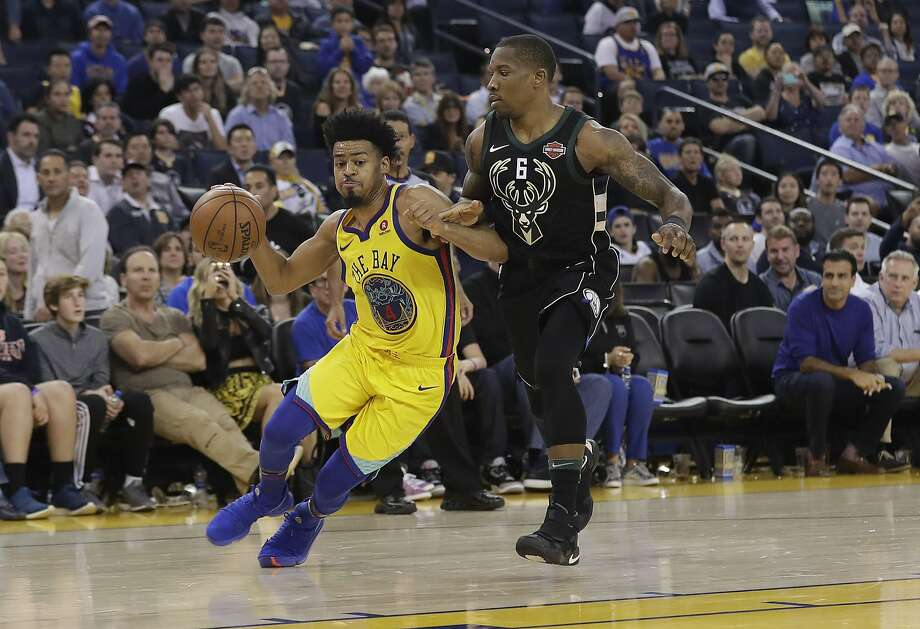Golden State Warriors' Quinn Cook drives against Milwaukee Bucks' Eric Bledsoe during the second half of an NBA basketball game Thursday, March 29, 2018, in Oakland, Calif. (AP Photo/Marcio Jose Sanchez) Photo: Marcio Jose Sanchez / Associated Press