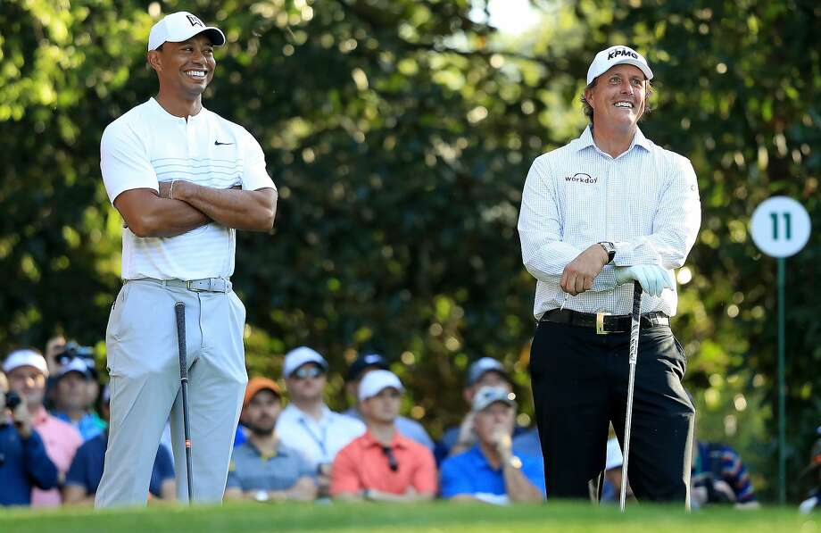 Tiger Woods and Phil Mickelson of the United States talk on the 11th hole  during a practice round prior to the start of the 2018 Masters Tournament at Augusta National Golf Club on April 3, 2018 in Augusta, Georgia.  Photo: Andrew Redington