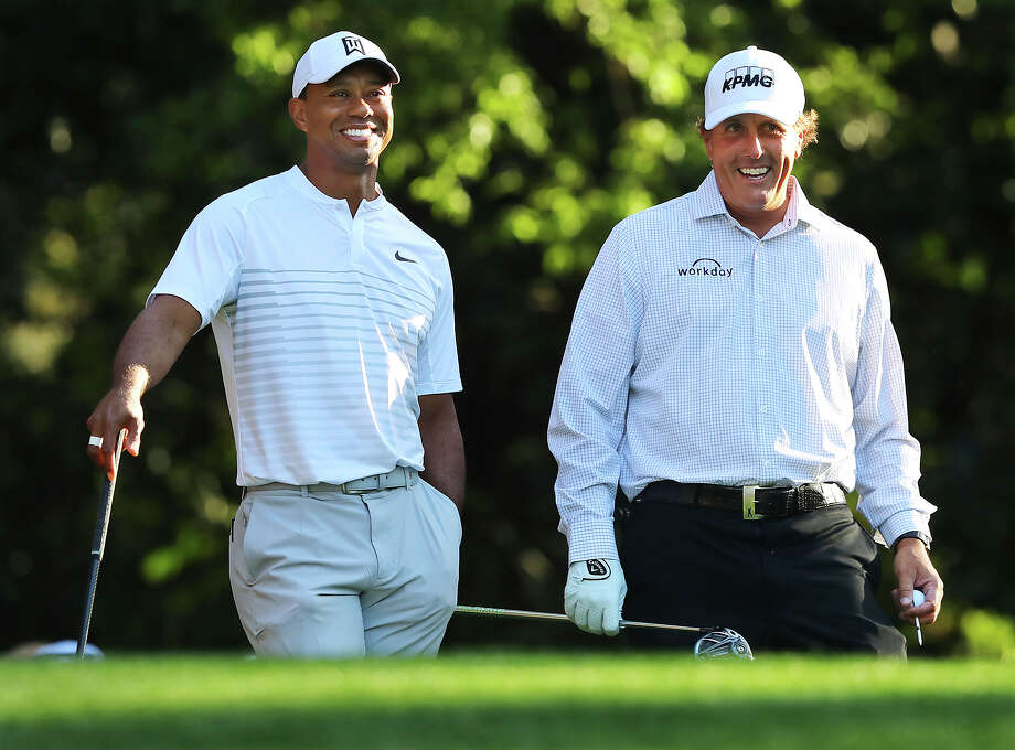 Tiger Woods, left, and Phil Mickelson share a laugh on the 11th tee box while playing a practice round for the Masters golf tournament at Augusta National Golf Club in Augusta, Ga., Tuesday, April 3, 2018. (Curtis Compton/Atlanta Journal-Constitution via AP) Photo: Ccompton@ajc.com / Atlanta Journal-Constitution