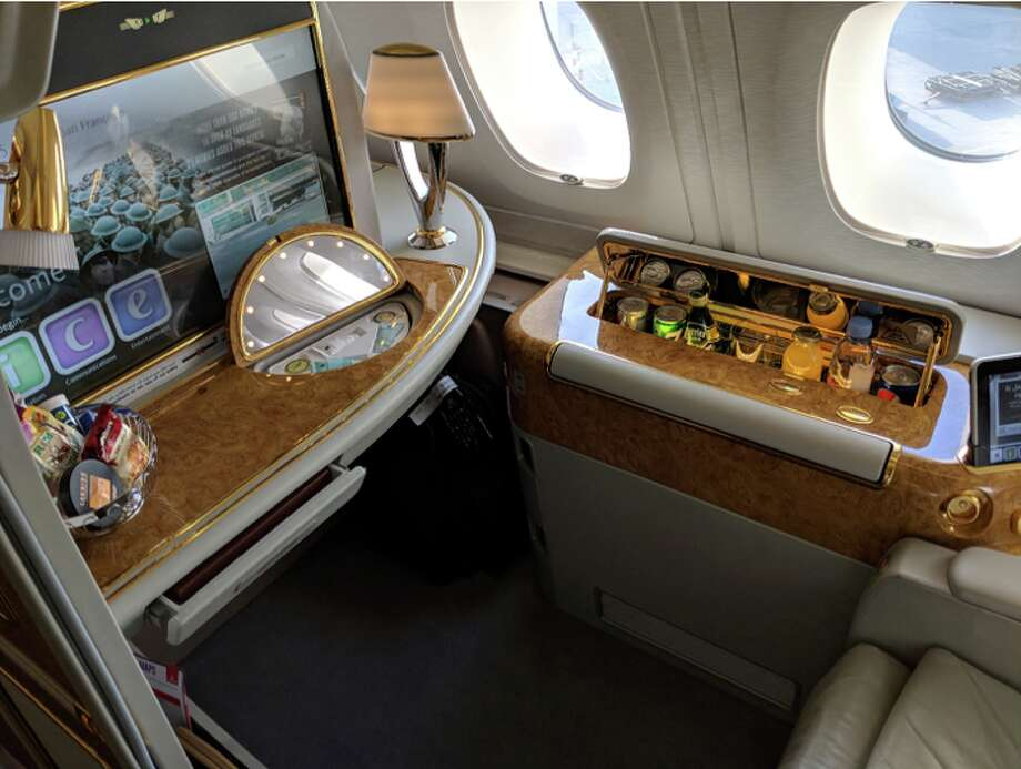 On an Emirates A380, each first class seat is well-equipped with a large monitor, snacks, extra toiletries and a private mini-bar Photo: Rich Walker