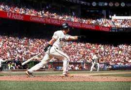Giants' Joe Panik watches his solo home run in the fouth inning, during the home opener for the San Francisco Giants as they prepare to take on the Seattle Mariners at AT&T Park in San Francisco, Calif., on Tues. April. 3, 2018.