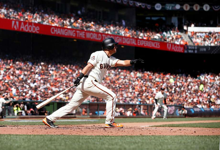 Giants' Joe Panik watches his solo home run in the fourth inning, during the home opener for the San Francisco Giants. Photo: Michael Macor / The Chronicle