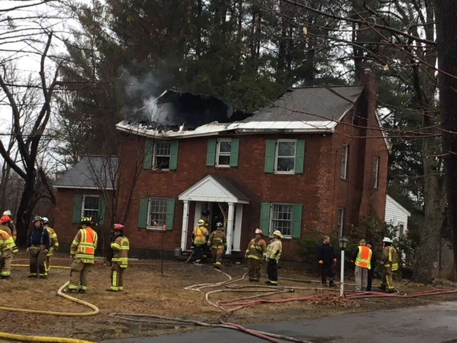 A fire at 2471 Rosendale Road in Niskayuna spread to an attic, collapsing the roof. Photo: Wendy Liberatore/Times Union