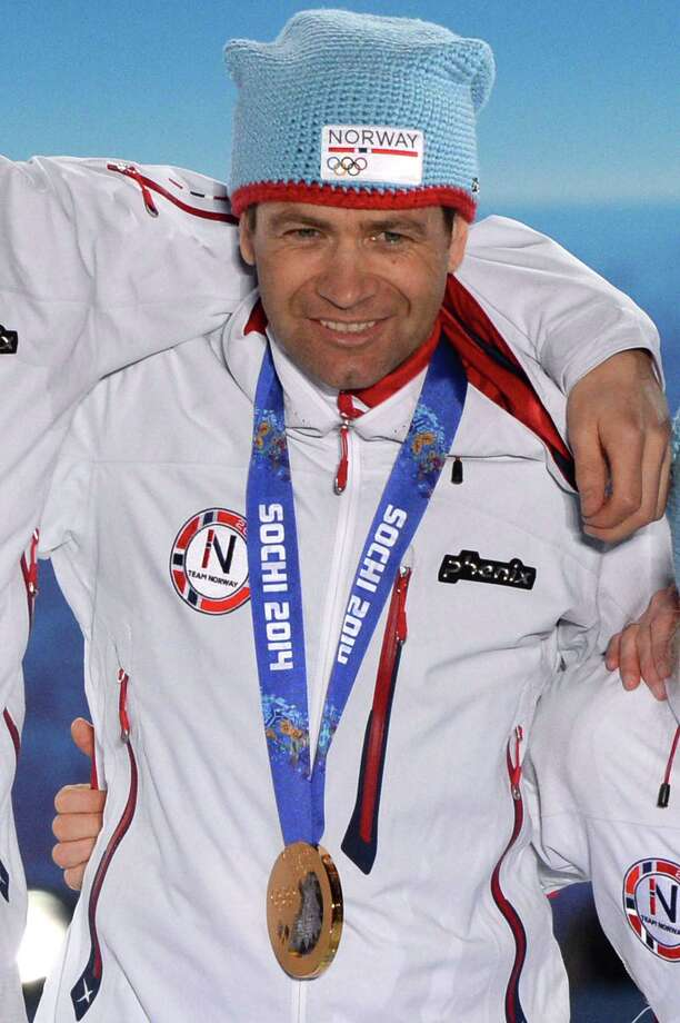 A picture taken with a robotic camera shows Norway's gold medalists Ole Einar Bjoerndalen posing during the Biathlon mixed 2x6 km + 2x7.5 km Relay Medal Ceremony at the Sochi medals plaza during the Sochi Winter Olympics on February 20, 2014.  AFP PHOTO / ANTONIN THUILLIERANTONIN THUILLIER/AFP/Getty Images ORG XMIT: 467666385 Photo: ANTONIN THUILLIER / AFP