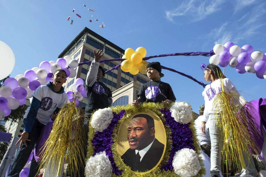 """Candy is thrown from the This and That Creative Corner float during The """"Original"""" MLK Parade in Houston on Monday, Jan. 15, 2018. Photo: Brett Coomer, Staff / Houston Chronicle / © 2018 Houston Chronicle"""
