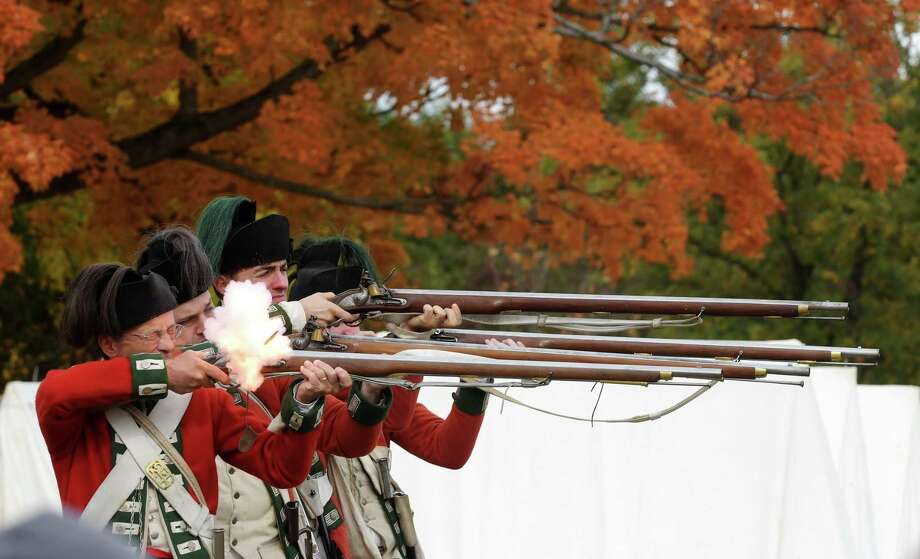 Revolutionary War re-enactors portraying the British 24th Regiment of Foot soldiers fire their muskets as they take part in an encampment at the Saratoga National Battlefield in Stillwater, N.Y., on Oct. 9, 2016. Photo: Doug Sehres, STAFF PHOTOGRAPHER / Albany Times Union / 20038300A