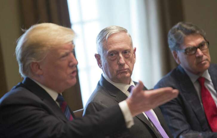 Jim Mattis, U.S. secretary of defense, center, listens as U.S. President Donald Trump, left, speaks during a meeting with Baltic leaders in the Cabinet Room of the White House in Washington, D.C., U.S., on Tuesday, April 3, 2018. Trump says the U.S. will expand exports of LNG to Baltic region and will hold a summit with the Baltic presidents of Lithuania, Latvia, and Estonia to discuss ways to expand economic opportunities. Photographer: Chris Kleponis/Pool via Bloomberg