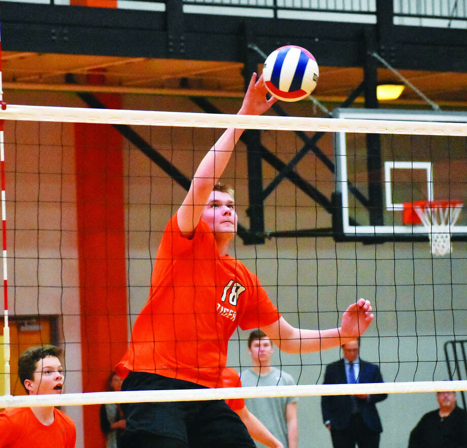 Edwardsville's Cal Werths slams down a kill during the second game against the Granite City Warriors on Tuesday inside Lucco-Jackson Gymnasium.