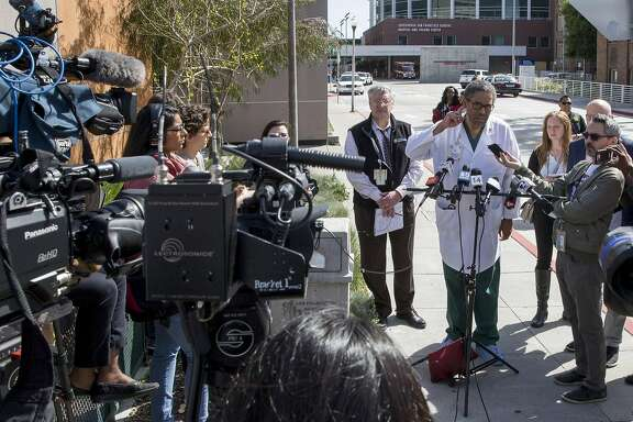 Trauma surgeon Andre Campbell answers questions outside Zuckerberg General Hospital and Trauma Center, Tuesday, April 3, 2018, in San Francisco, Calif. Police responded to a report of an active shooter at YouTube headquarters in the city of San Bruno. Three victims were transported to S.F. General Hospital.