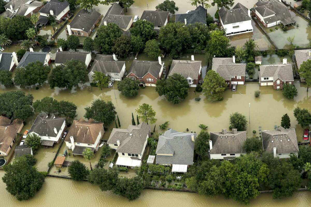 Floodwaters from the Addicks Reservoir inundate a neighborhood off N. Eldridge Parkway in the aftermath of Tropical Storm Harvey on Wednesday, Aug. 30, 2017, in Houston. ( Brett Coomer / Houston Chronicle )