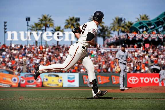 Giants' Evan Longoria watches his two run 6th inning home run during the home opener, the San Francisco Giants went on to lose to the Seattle Mariners 6-4 at AT&T Park in San Francisco, Calif., on Tues. April. 3, 2018.