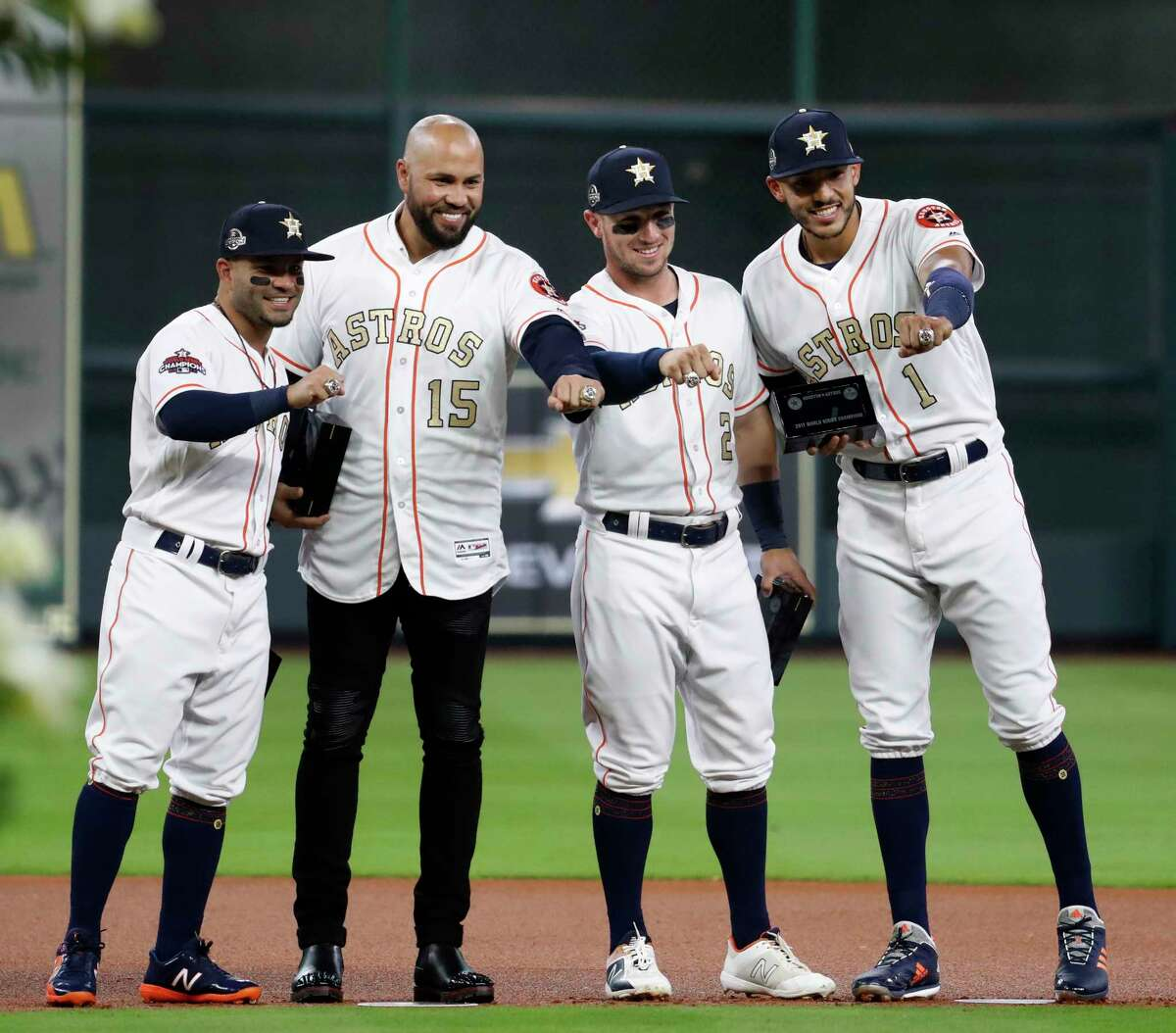 Houston Astros Carlos Correa (1) and Alex Bregman (2), Carlos Beltran, and Jose Altuve their new World Series rings before the start of an MLB baseball game at Minute Maid Park, Tuesday, April 3, 2018, in Houston.
