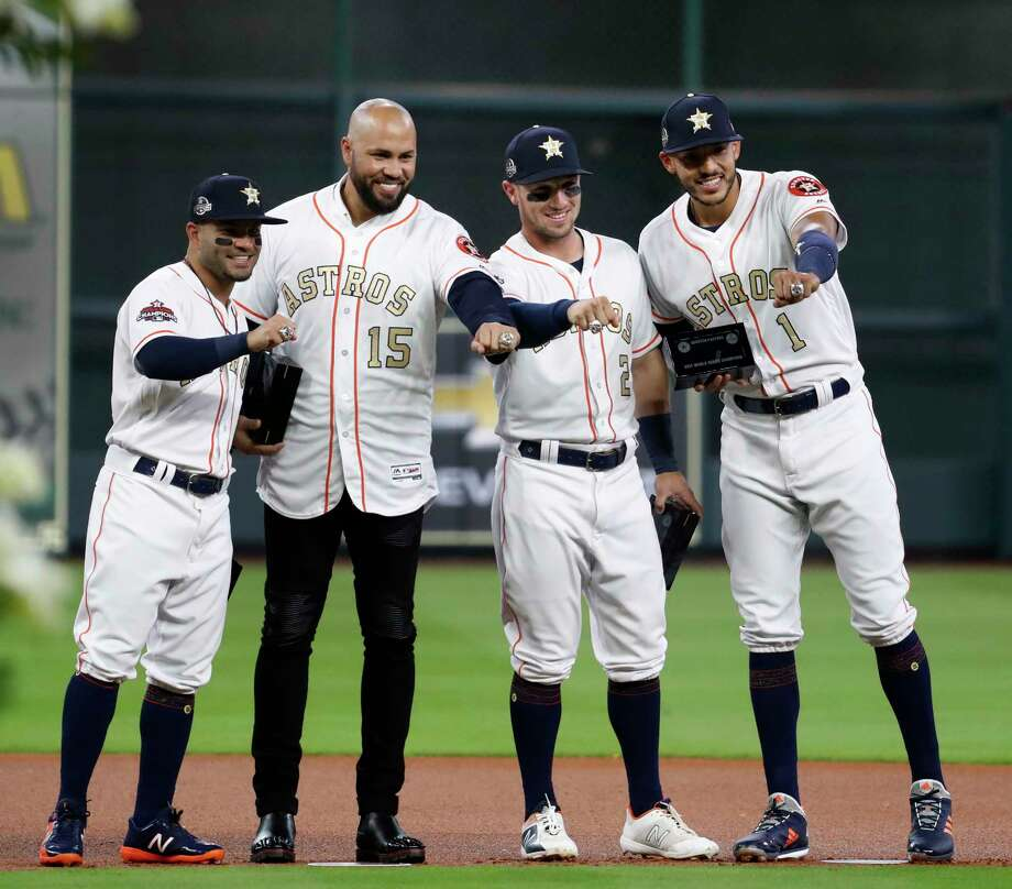 Houston Astros Carlos Correa (1) and Alex Bregman (2), Carlos Beltran, and Jose Altuve  their new World Series rings before the start of an MLB baseball game at Minute Maid Park, Tuesday, April 3, 2018, in Houston. Photo: Karen Warren, Houston Chronicle / © 2018 Houston Chronicle
