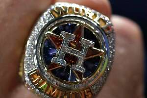 Houston Astros Reid Ryan shows off his new World Series ring before the start of an MLB baseball game at Minute Maid Park, Tuesday, April 3, 2018, in Houston.