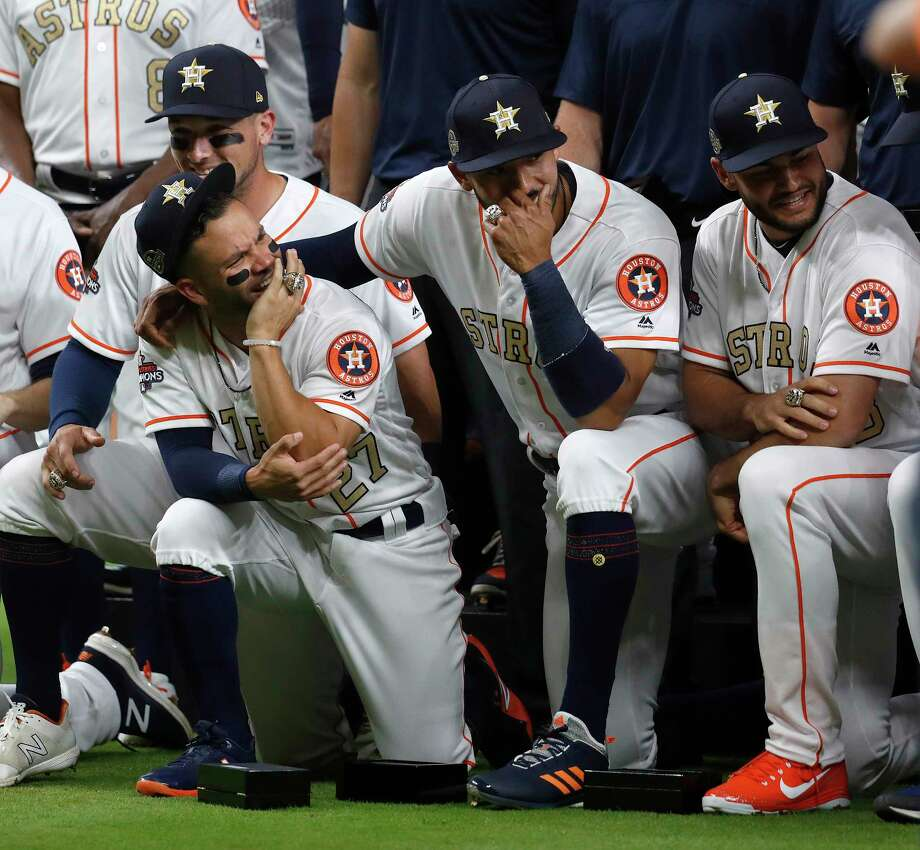 Houston Astros Carlos Correa (1) and Jose Altuve during their group photo with their new World Series rings before the start of an MLB baseball game at Minute Maid Park, Tuesday, April 3, 2018, in Houston. Photo: Karen Warren, Houston Chronicle / © 2018 Houston Chronicle