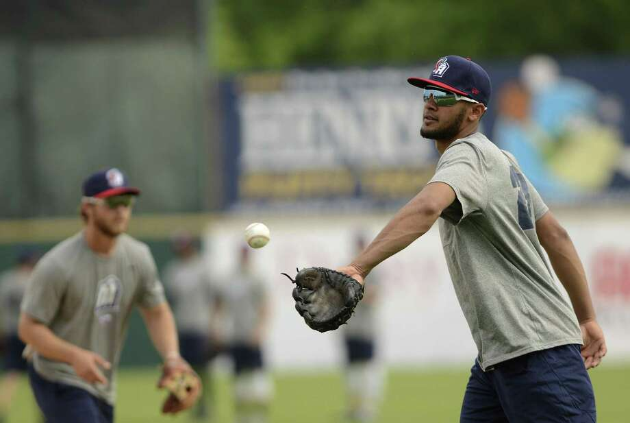 San Antonio Missions shortstop Fernando Tatis tosses the ball during infield practice at Media Day for the San Antonio Missions baseball team at Nelson Wolff Stadium on Tuesday, April 3, 2018. Photo: Billy Calzada, Staff / San Antonio Express-News / San Antonio Express-News