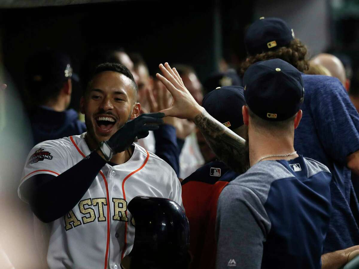 Houston Astros shortstop Carlos Correa (1) reacts after hitting an inside the park home run during the first inning an MLB baseball game at Minute Maid Park, Tuesday, April 3, 2018, in Houston.