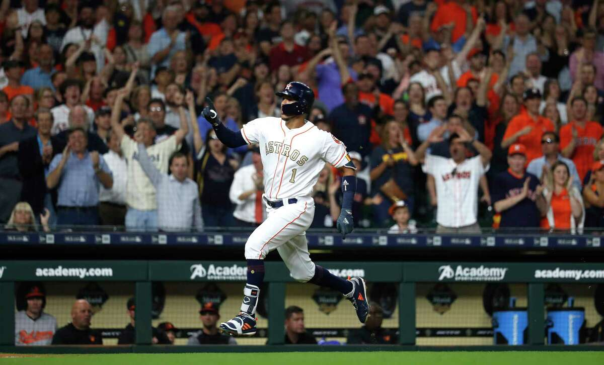 Houston Astros shortstop Carlos Correa (1) hits an inside the park home run during the first inning an MLB baseball game at Minute Maid Park, Tuesday, April 3, 2018, in Houston.