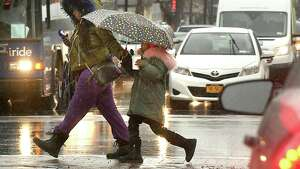 A couple pedestrians cross Washington Ave. at Henry Johnson Blvd. on Tuesday, April 3, 2018 in Albany, N.Y. (Lori Van Buren/Times Union)