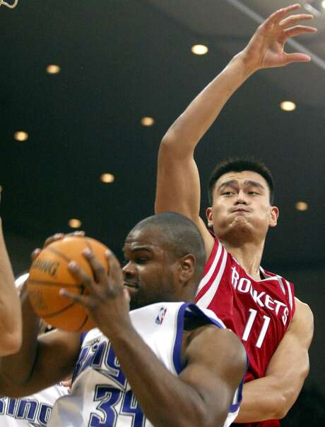Houston Rockets' Yao Ming (11) attempts to prevent Sacramento Kings' Alton Ford from scoring during the Beijing game of what is the first-ever NBA presentation game in China at the Capital Gymnasium in Beijing, China, Sunday, Oct. 17, 2004. The Sacramento Kings won 91-89. Photo: NG HAN GUAN, STF / AP / AP