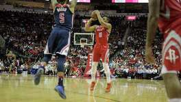 Houston Rockets guard Eric Gordon (10) puts up a three-point shot in the first half against the Washington Wizards at the Toyota Center on Tuesday, April 3, 2018, in Houston.