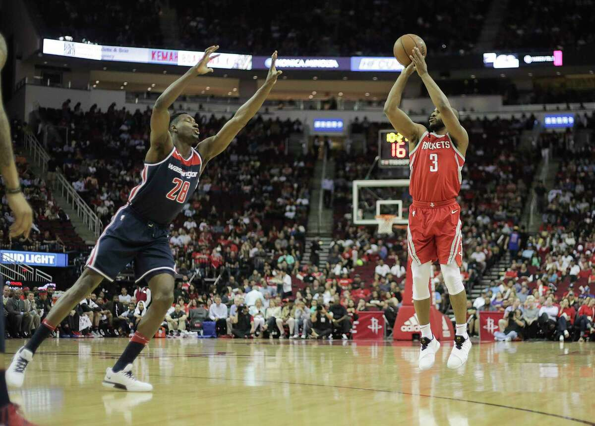 Houston Rockets guard Chris Paul (3) puts up a three-point shot in the first half against the Washington Wizards at the Toyota Center on Tuesday, April 3, 2018, in Houston.