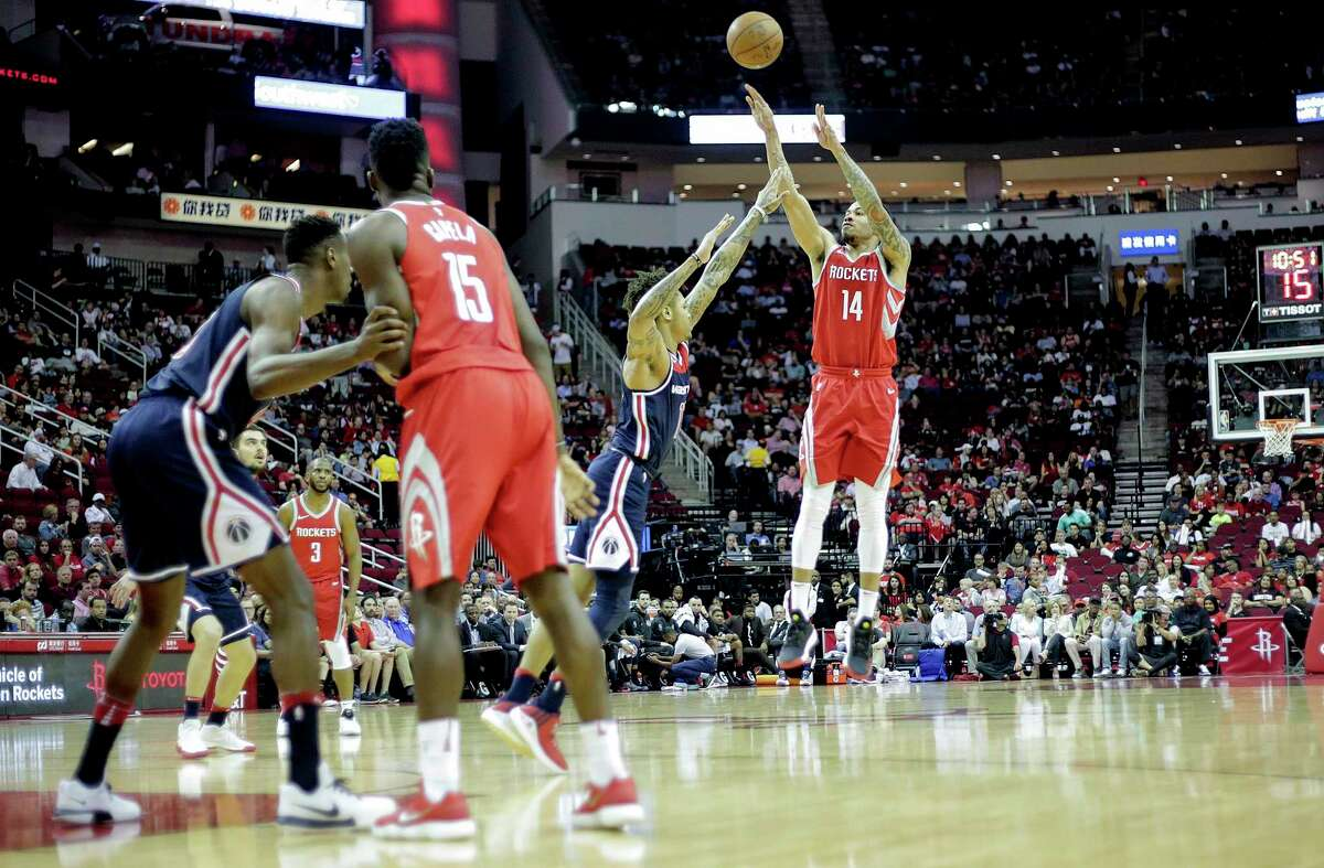 Houston Rockets guard Gerald Green (14) puts up a three-point shot in the first half against the Washington Wizards at the Toyota Center on Tuesday, April 3, 2018, in Houston.