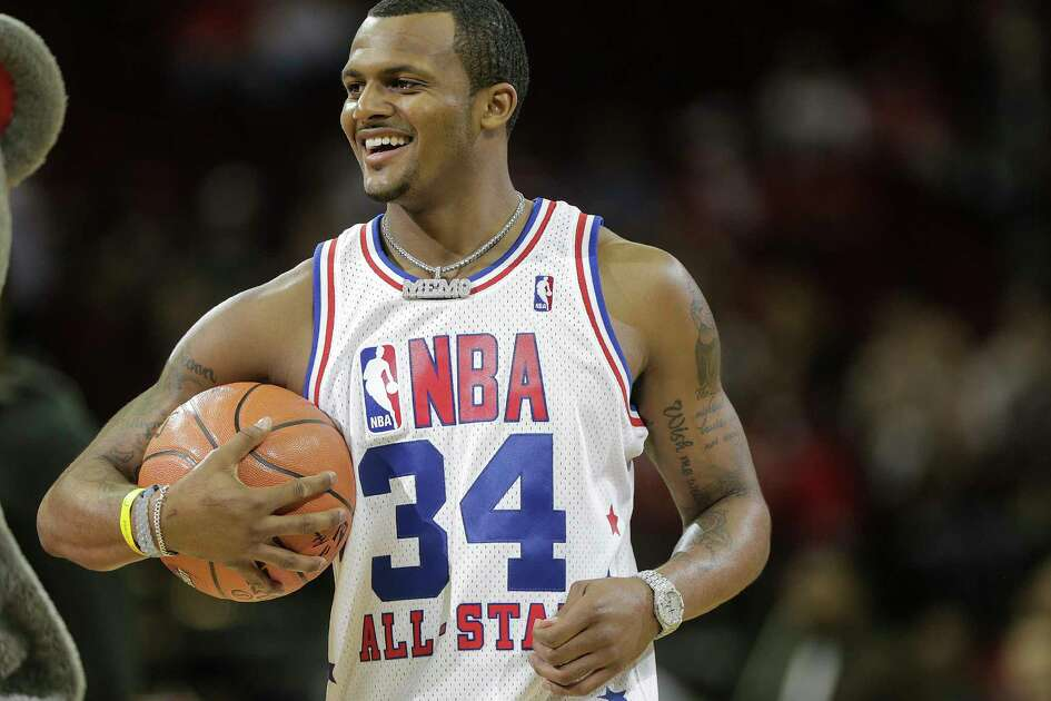 Texans quaterback Deshaun Watson gets ready to take a shot for a fundraiser becore the Houston Rockets host Washington Wizards at the Toyota Center on Tuesday, April 3, 2018, in Houston.