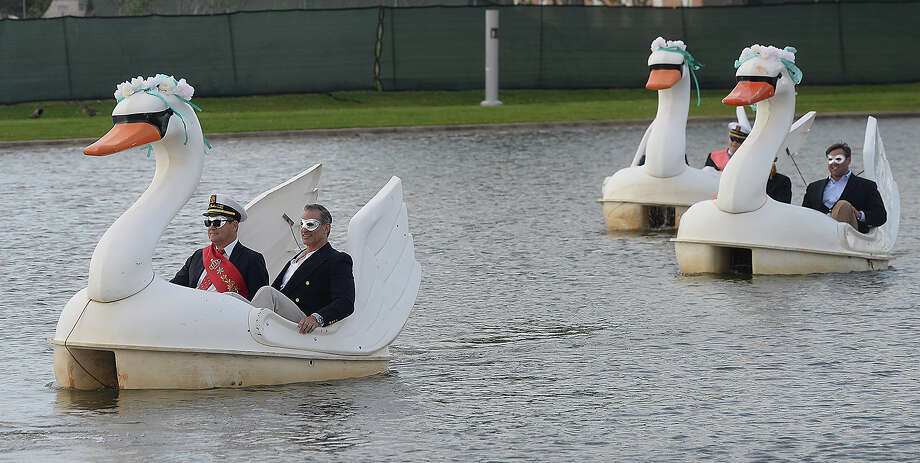King Neches LXX and his court make their way toward the Event Centre across the poind on swan paddle boats for the Neches River Festival unveiling ceremony Tuesday.  Photo taken Tuesday, April 3, 2018 Kim Brent/The Enterprise Photo: Kim Brent / BEN
