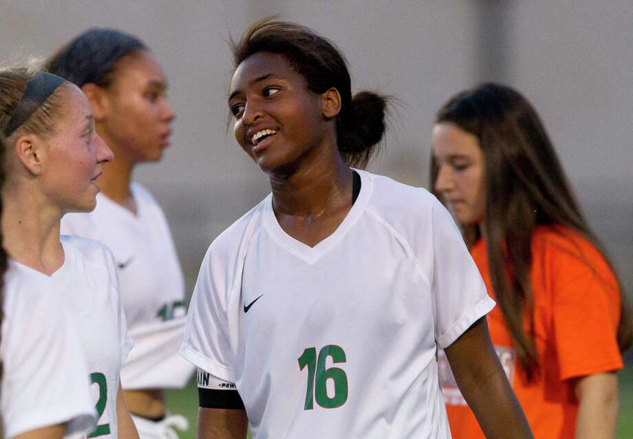 The Woodlands forward Jazzy Richards (16) smiles after her hat-trick performance in the Highlander's 3-0 shutout victory over Rockwallduring a Region II-6A bi-district playoff match at Nacogdoches High School, Thursday, March 29, 2018, in Nacogdoches. Photo: Jason Fochtman, Staff Photographer / © 2018 Houston Chronicle